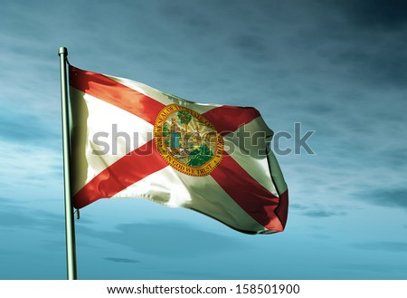 Florida (USA) flag waving in the evening - stock photo