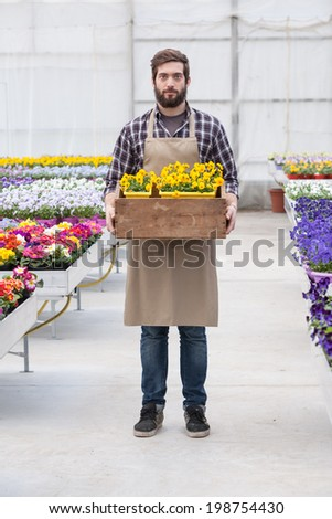 Florist Carrying flowers In a Tray - stock photo