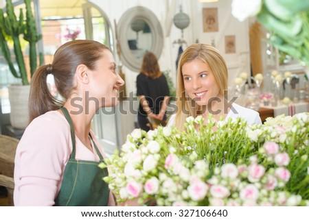 Florist interacting with customer - stock photo