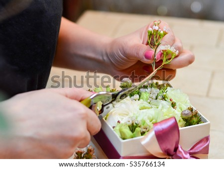 Florist making bouquet in a small box
