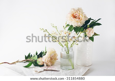 Florist preparation with a selection of vases scissors and string horizontal - stock photo