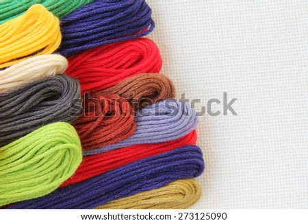 Floss and fabric for embroidery (colored cotton thread)
