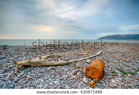 Flotsam and jetsam washed up on the beach at Porlock Weir on the Exmoor coastline in Somerset - stock photo