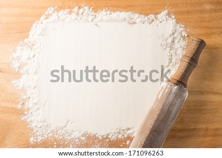 Flour and battledore on a cutting board