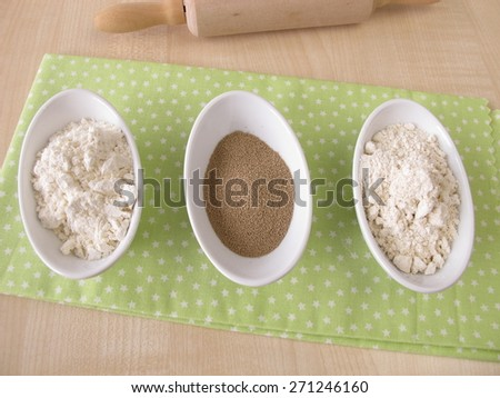 Flour and dry baker's yeast - stock photo