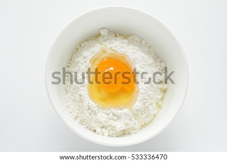 flour and egg for pancake cooking image