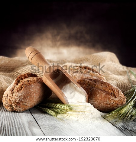 flour and few breads  - stock photo