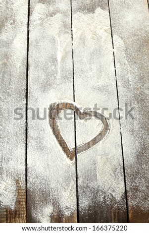 flour and white heart of love  - stock photo