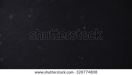 flour dust particles on black background, motion blur