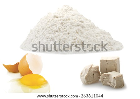 Flour,egg and Yeast cubes close up on the white - stock photo