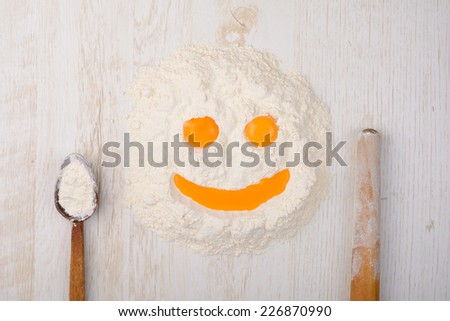 flour, eggs, baking ingredients on a table - stock photo