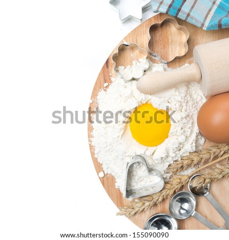flour, eggs, rolling pin, measuring spoons and baking forms, top view, isolated on white - stock photo