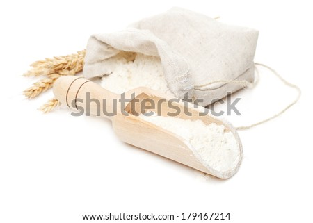flour in bag and scoop isolated on white background - stock photo