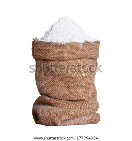 flour in bag on white background - stock photo