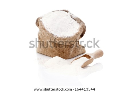 Flour in brown burlap sack isolated on white background. Bread making concept.  - stock photo