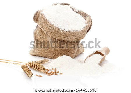 Flour in burlap sack. Flour and rye crop isolated on white background. Baking concept.  - stock photo