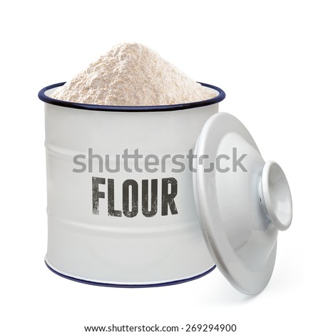 Flour in enamel canister with lid on white background - stock photo