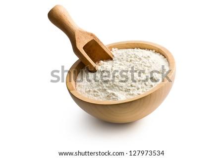 flour in wooden bowl on white background - stock photo