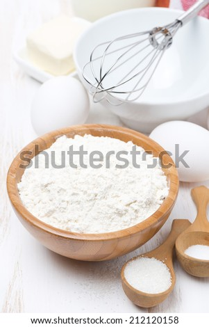 flour, salt, sugar and eggs for baking pancakes, vertical, close-up - stock photo