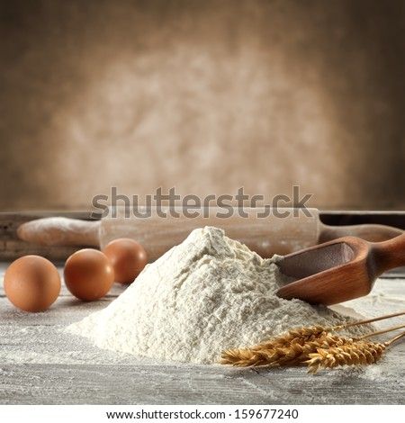 flour spoon and roller  - stock photo