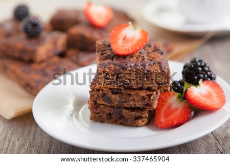 Flourless healthy pumpkin brownies with chocolate chips, selective focus