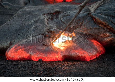 Flow of red hot lava  in the dark, Big Island, Hawaii  - stock photo