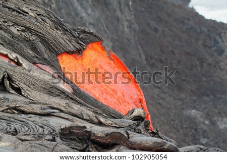 flow of red hot lava into Pacific Ocean closeup - stock photo