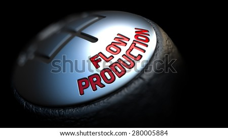 Flow Production - Red Text on Car's Shift Knob on Black Background. Close Up View. Selective Focus. - stock photo