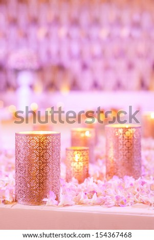 Flower and candle decoration for a wedding - stock photo
