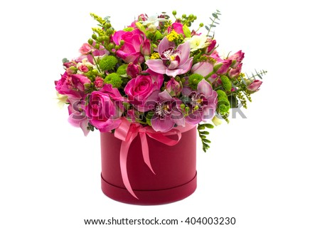 Flower arrangement in a hat box , a pot of pink for a girl on a gift with roses , orchids , freesia on a white background - stock photo