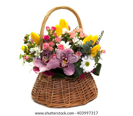 Flower arrangement in a wicker basket for a girl of roses, tulips and orchids on a white background