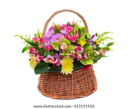 Flower arrangement in a wicker basket  for women  - stock photo