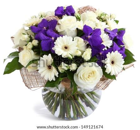 Flower arrangement in glass, transparent vase: White roses, purple orchids, white gerbera daisies, green peas. Isolated on white. Floristic composition, design a bouquet, floral arrangement.  - stock photo