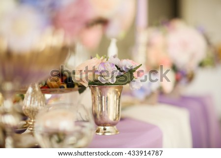 flower arrangement in silver bowl with pink peonies and hydrangea