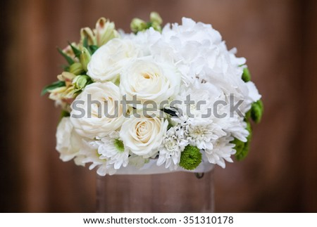 Flower arrangement of white chrysanthemums on a wedding banquet table