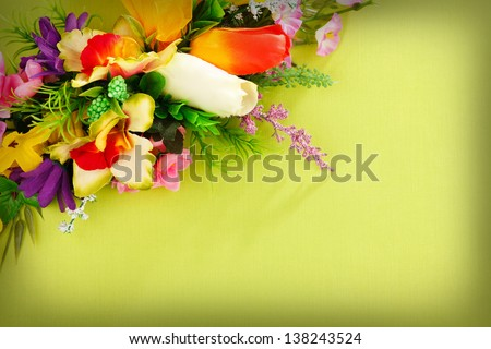 flower arrangement on a green background with blank  for advertisement
