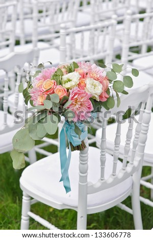 Flower Arrangement on Wedding Aisle - stock photo