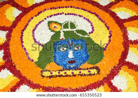 Flower bed decoration, seamless floral pattern of tropical fresh flowers on Onam, Vishu celebration of Kerala, India. Indian festival. Colourful design of Sri Krishna