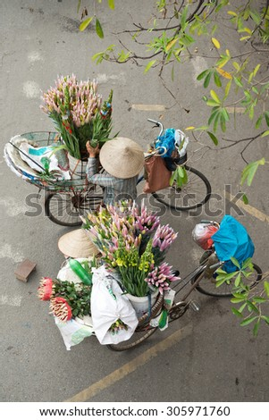 Flower Bike Vendors in Hanoi, Vietnam - stock photo
