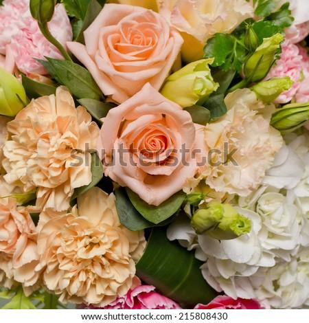 flower bouquet background- orange, pink, white flowers bouquet. - stock photo