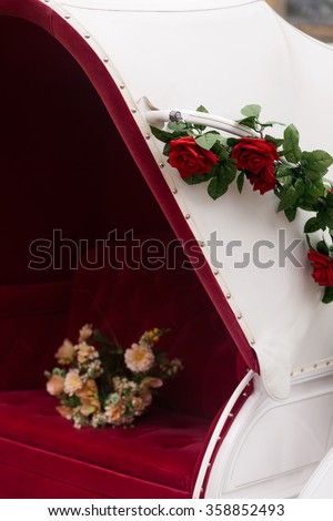 flower Bouquet on a red seat of a wedding carriage