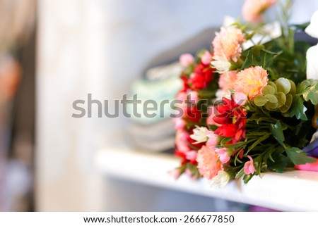 Flower Bouquet on Clothing Shelf - Close up of a fresh floral bouquet in a wardrobe shelf   - stock photo