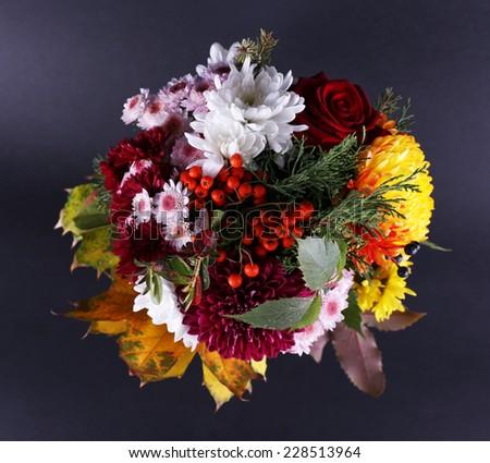 Flower bouquet on dark grey background - stock photo