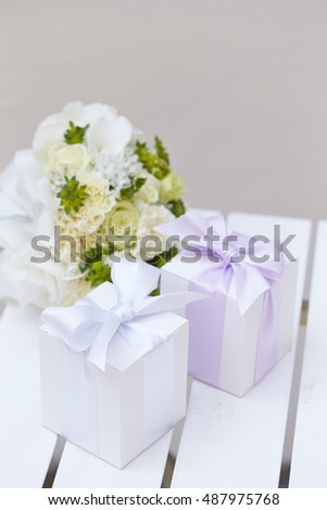 Flower bouquet with gift boxes