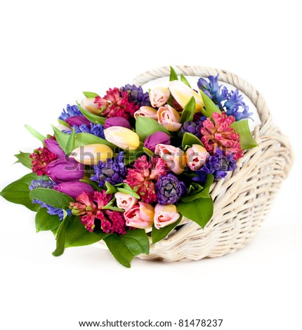 Flower composition with multicolored tulips in basket - stock photo