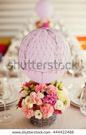 flower composition with purple baloon - stock photo