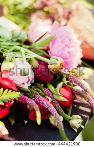 flower composition with ranunculus and peonies - stock photo