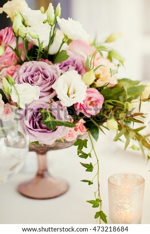 flower composition with roses, eustoma and hydrangea
