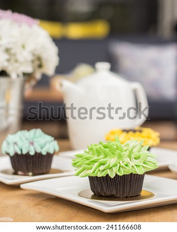 Flower cupcakes on the table - stock photo