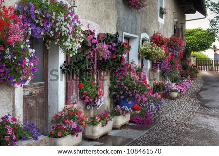 Flower decorated house at Albens, Savoie - France - stock photo